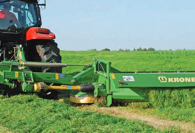 tractor mowing grass silage